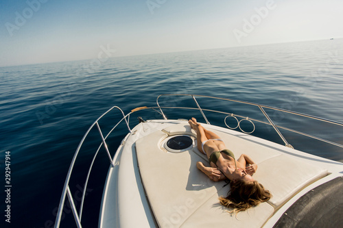 Pretty young woman on the yacht at summer