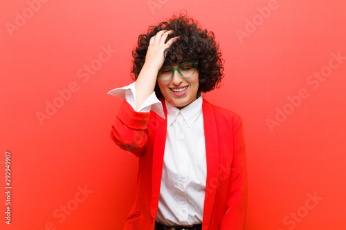 Fotografie, Obraz  young pretty afro woman laughing and slapping forehead like saying d'oh! I for