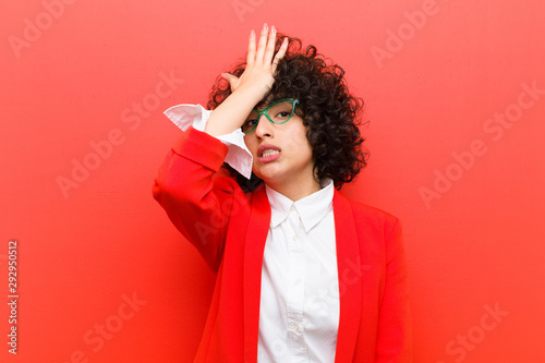 young pretty afro woman raising palm to forehead thinking oops, after making a s Slika na platnu