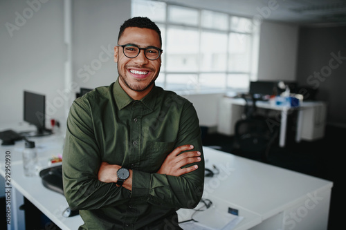 Valokuva Portrait of a happy confident young african american businessman standing with h