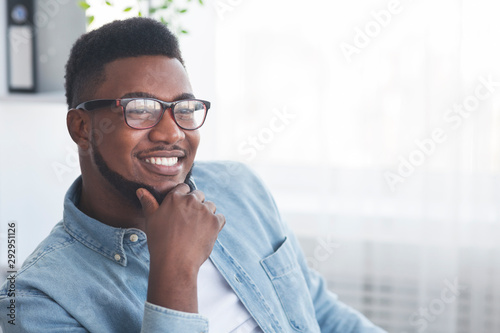 Fototapeta Portrait of handsome smiling african american man in glasses obraz