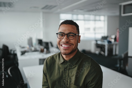 Fotografering Friendly and smiling young african american professional businessman looking at