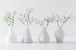 Leinwanddruck Bild - Home interior floral decor. Elegant floral soft white composition. Beautiful white gypsophila flower in vase on white wall background.