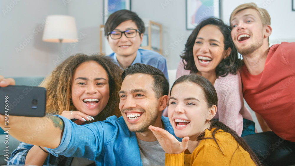 Fototapety, obrazy: At Home Diverse Group of Friends Doing Collective Selfie, Guy Holds Smartphone People Smile, Laugh and do Duck Lips.Young People Doing Live Stream of the Home Party.