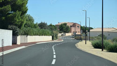 En roulant : entrée dans le village de La Palme, Aude, Occitanie Canvas Print