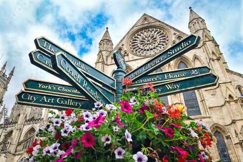 The York Minster and a sign with directions to landmarks in the city