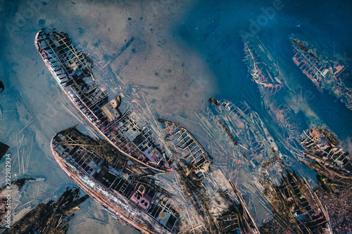 Cemetery of old ships in Teriberka Murmansk Russia, dramatic photo. Aerial top view