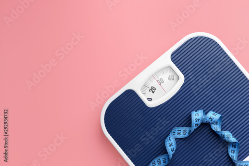 Fotografia Scales and measuring tape on color background