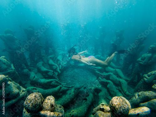 Obraz na plátně Freediving Girl swims over Underwater sculptures gili Meno, Southeast Asia