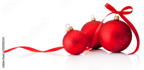 Three red Christmas decoration baubles with ribbon bow isolated on white background
