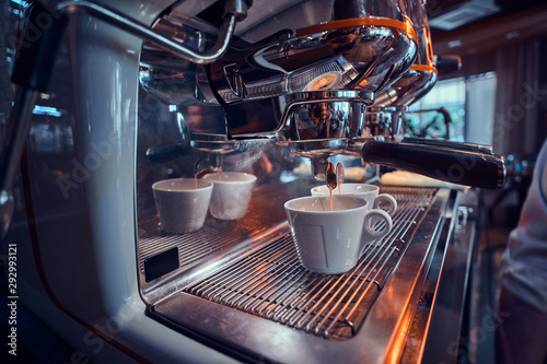 New shiny coffee machine at coffee shop is ready to start making coffee фототапет