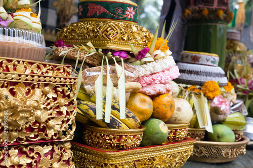 Traditional offerings to gods in Indonesia with flowers, fruits and aromatic sticks in temple, buddhist