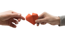 Red Heart In Woman And Man Hands. Image On Isolated White Background. Concept Of Love,  Giving Gifts, Donorship.