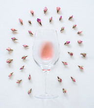 Rose Wine In A Glass Flat Lay With Dried Rose Buds, Pink Wine With Dried Flowers White Background