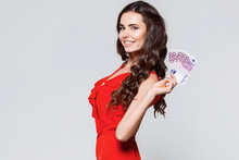 Portrait Of Happy Smiling Beautiful Brunette Young Woman Holding Euro Money Isolated Over Gray Background. Sale, Finance, Banking, Winning, Economic, Credit, Business, Shopping Concept.
