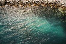 Aerial View Of Sea Waves And Some Of Rocks