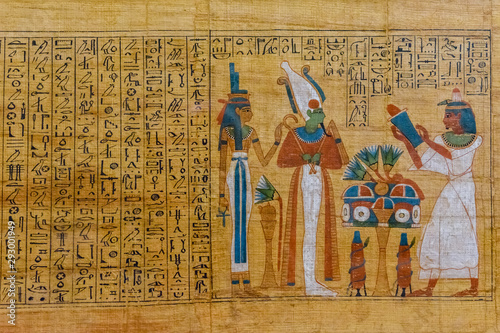 Egyptian ancient papyrus with the different pictures and hieroglyphics Fototapeta