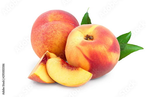 Obraz na płótnie Ripe peach fruit and slice with leaf isolated on white background