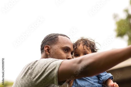 Fototapeta Father holding his little girl. Mixed race family. obraz na płótnie