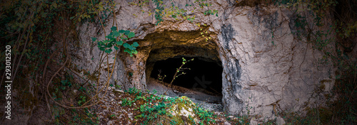 Cuadros en Lienzo  wide shot of mountain cave used as a hideout during the Second World War in the