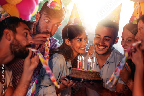 Obraz Group of friends celebrating birthday together - fototapety do salonu