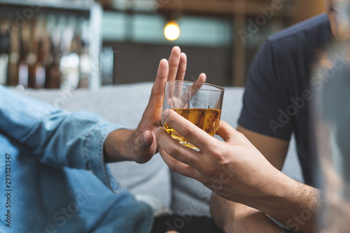 Photo Stop alcohol concept. Person refuse to drink alcohol.
