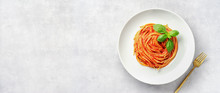 Top View Of Plate Eith Pasta In Tomato Sauce And Basil On White Background