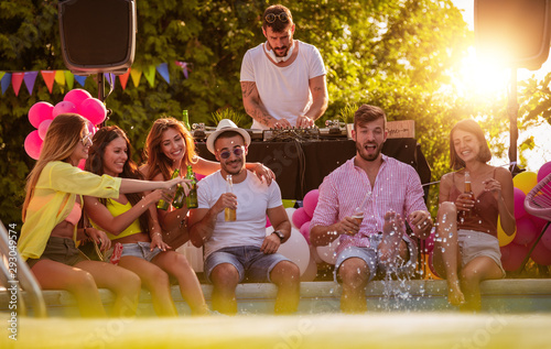 Beautiful young people having fun near swimming pool - 293049574