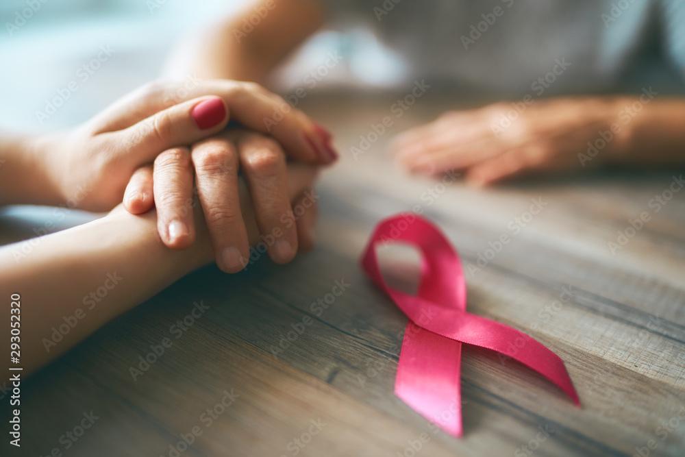 Fototapeta Females hands and symbol of Breast Cancer Awareness