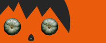 Halloween Monster Face With Blue Pumpkin Eyes On Orange Background