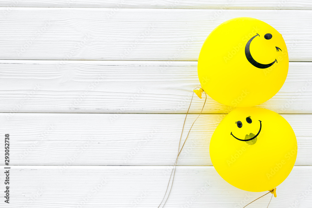 Fototapeta Happiness emotion. Yellow balloon with smile on white wooden background top view space for text