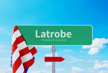 Latrobe – Pennsylvania. Road Or Town Sign. Flag Of The United States. Blue Sky. Red Arrow Shows The Direction In The City. 3d Rendering