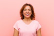 canvas print picture middle age woman smiling positively and confidently, looking satisfied, friendly and happy against pink wall