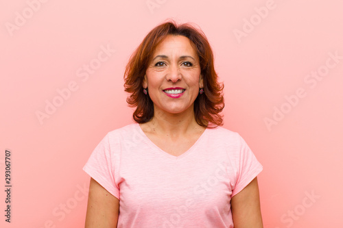middle age woman smiling positively and confidently, looking satisfied, friendly Wallpaper Mural