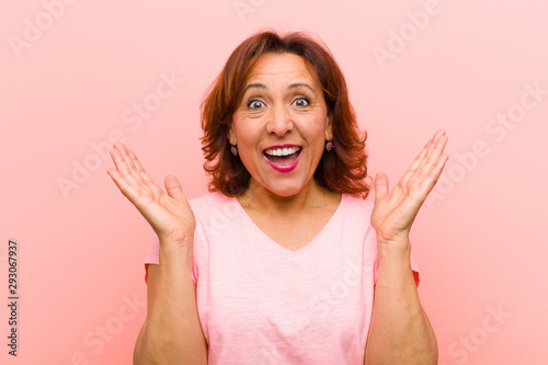 middle age woman looking happy and excited, shocked with an unexpected surprise Tapéta, Fotótapéta