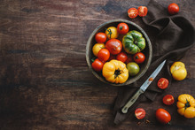 Colorful Ripe Organic Tomatoes In Bowl. Fall Heirloom. Food Background, Close Up View, Flat Lay
