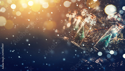 Foto op Canvas Kerstmis Close-up, Elegant Christmas tree in glass jar with snowflakes background. copy space.