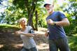 Leinwandbild Motiv Mature or senior couple doing sport outdoors, jogging in a park