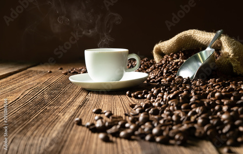 Wall Murals Cafe Cup of espresso with coffee beans, bag, scoop and steam
