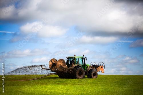 Tractor abonando el campo Canvas Print