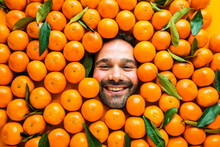 Man With Ripe Oranges Or Cleme...