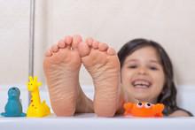 Baby Wash In The Bath. Little Girl Feet In The Bathtub. Bath Time.