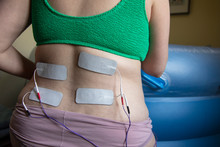 A Pregnant Woman In Labour Wearing A Tens Machine As Pain Relief