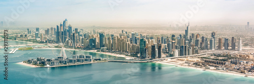 Panoramic aerial view of Dubai Marina skyline with Dubai Eye ferris wheel, Unite Wallpaper Mural