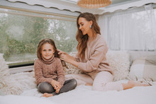 Happy Family - Mother And Little Daughter Relaxing And Having Fun In Countryside Inside Camper Van
