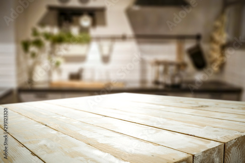 Fototapeta White wooden table and kitchen furniture  obraz