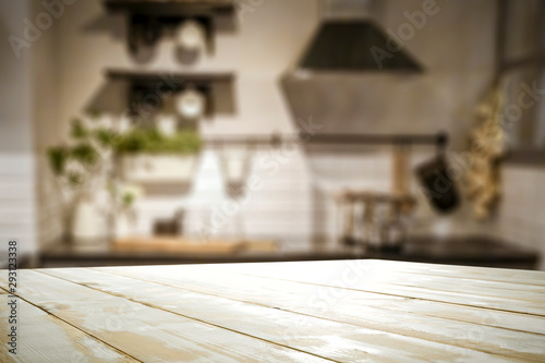Photo sur Toile Pays d Europe White wooden table and kitchen furniture