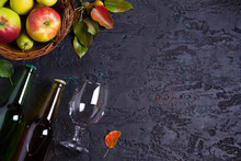Bottles And Glass Of Apple And Pear Cider With Fruits On Black Background. View From Above, Top View. Room For Text, Copy Space