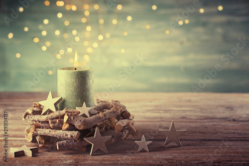 Christmas candle with magic lights  -  Natural advent decoration -  Wreath made of twigs  -  Rustic  simple background