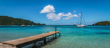 Panoramic Sea And Harbor View With Wooden Pier At The Beach Of Bequia, St Vincent And The Grenadines.